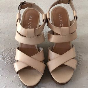 Cream colored sandals with wooden heels.